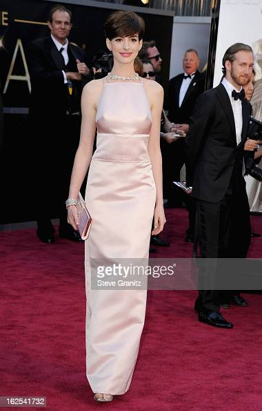 Actress Anne Hathaway wearing Giorgio Armani arrives at the Oscars at Hollywood Highland Center on February 24 2013 in Hollywood California