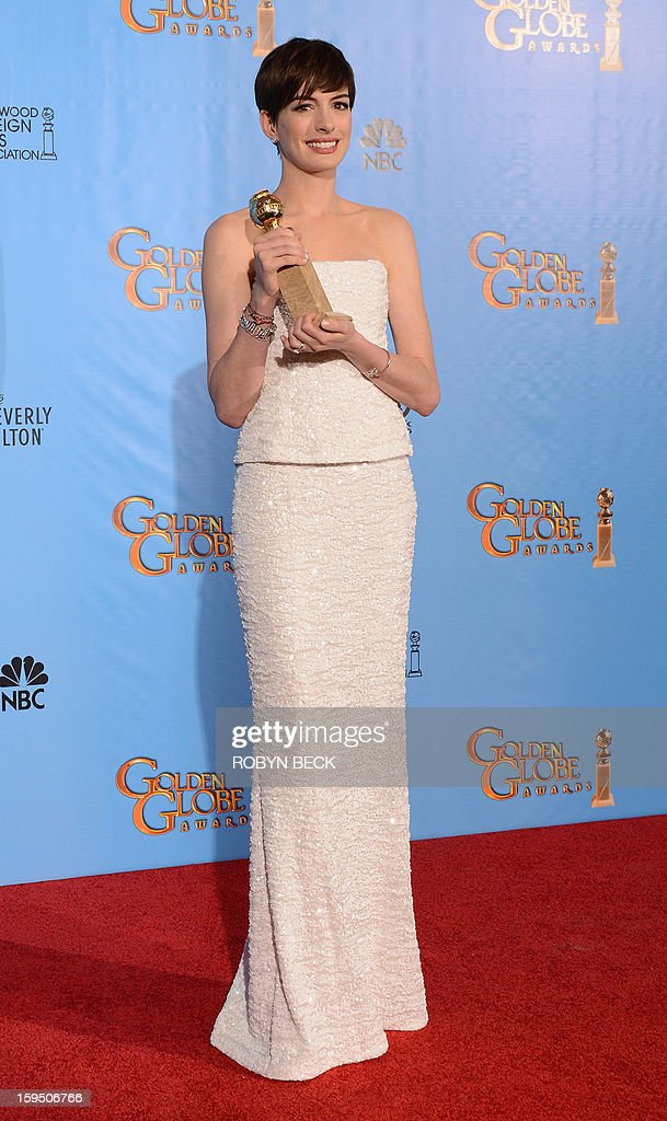 Actress Anne Hathaway, winner of Best Supporting Actor in a Motion Picture for 'Les Miserables,' poses in the press room during the 70th Annual Golden Globe Awards held at The Beverly Hilton Hotel on January 13, 2013 in Beverly Hills, California. AFP PHOTO/Robyn BECK