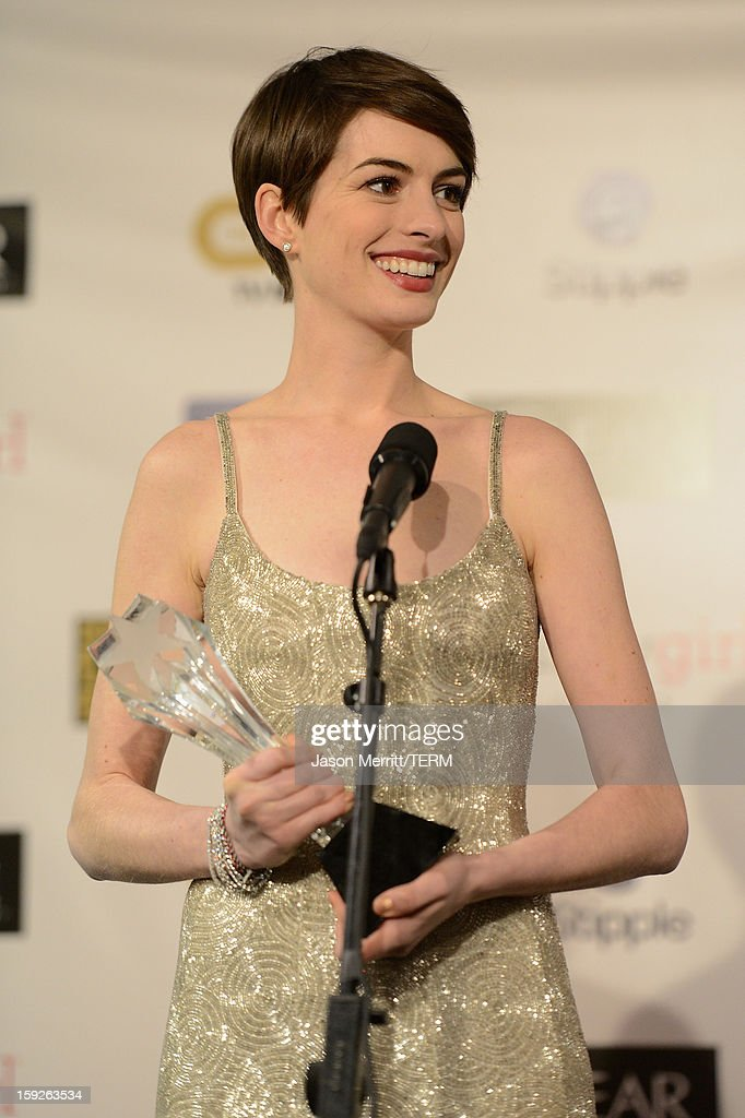 Actress <a gi-track='captionPersonalityLinkClicked' href=/galleries/search?phrase=Anne+Hathaway+-+Actress&family=editorial&specificpeople=11647173 ng-click='$event.stopPropagation()'>Anne Hathaway</a>, winner of Best Supporting Actress for 'Les Miserables,' poses in the press room at the 18th Annual Critics' Choice Movie Awards held at Barker Hangar on January 10, 2013 in Santa Monica, California.