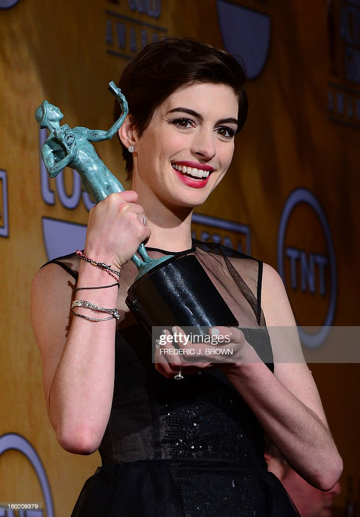 Actress Anne Hathaway, winner of Outstanding Performance by a Female Actor in a Supporting Role for 'Les Miserables,' poses in the press room during the 19th Annual Screen Actors Guild Awards held at The Shrine Auditorium on January 27, 2013 in Los Angeles, California. AFP PHOTO / Frederic J. BROWN