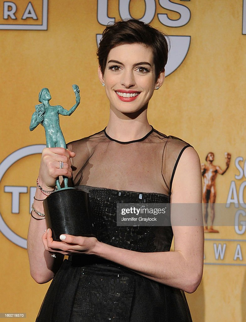 Actress <a gi-track='captionPersonalityLinkClicked' href=/galleries/search?phrase=Anne+Hathaway+-+Actress&family=editorial&specificpeople=11647173 ng-click='$event.stopPropagation()'>Anne Hathaway</a>, winner of Outstanding Performance by a Female Actor in a Supporting Role for 'Les Miserables', poses in the press room during the 19th Annual Screen Actors Guild Awards held at The Shrine Auditorium on January 27, 2013 in Los Angeles, California.