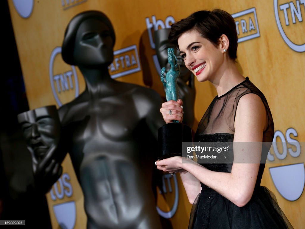 Actress <a gi-track='captionPersonalityLinkClicked' href=/galleries/search?phrase=Anne+Hathaway+-+Actrice&family=editorial&specificpeople=11647173 ng-click='$event.stopPropagation()'>Anne Hathaway</a>, winner of Outstanding Performance by a Female Actor in a Supporting Role for 'Les Miserables,' poses in the press room at the 19th Annual Screen Actors Guild Awards at the Shrine Auditorium on January 27, 2013 in Los Angeles, California.