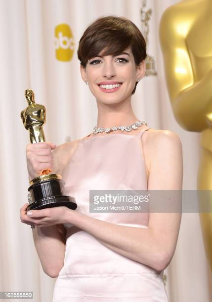 Actress Anne Hathaway winner of the Best Supporting Actress award for 'Les Miserables' poses in the press room during the Oscars held at Loews...