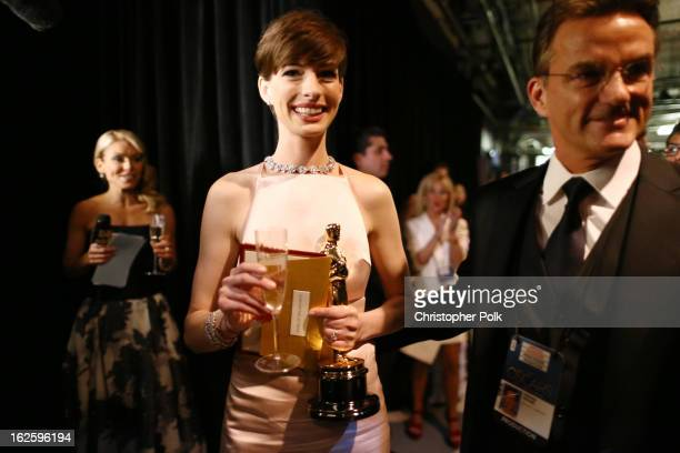 Actress Anne Hathaway winner of the Best Supporting Actress award for 'Les Miserables' backstage during the Oscars held at the Dolby Theatre on...