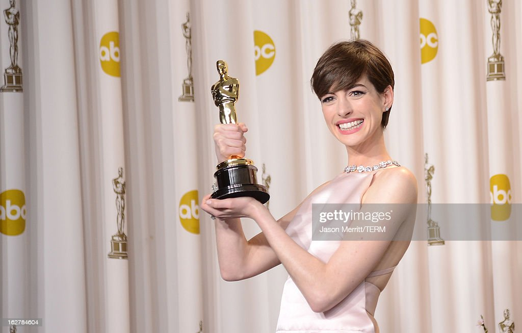 Actress Anne Hathaway, winner of the Best Supporting Actress award for 'Les Miserables,' poses in the press room during the Oscars held at Loews Hollywood Hotel on February 24, 2013 in Hollywood, California.