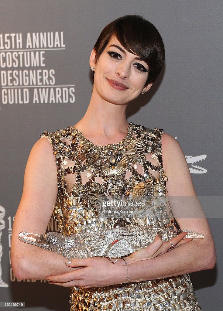 Actress <a gi-track='captionPersonalityLinkClicked' href=/galleries/search?phrase=Anne+Hathaway+-+Actrice&family=editorial&specificpeople=11647173 ng-click='$event.stopPropagation()'>Anne Hathaway</a>, winner of the Lacoste Spotlight Award, attends the 15th Annual Costume Designers Guild Awards with presenting sponsor Lacoste at The Beverly Hilton Hotel on February 19, 2013 in Beverly Hills, California.