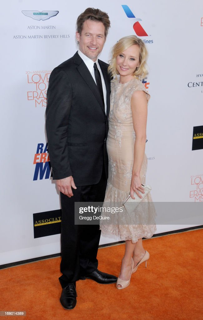 Actress Anne Heche (R) and James Tupper arrive at the 20th Annual Race To Erase MS Gala 'Love To Erase MS' at the Hyatt Regency Century Plaza on May 3, 2013 in Century City, California.