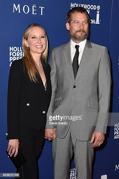 Actress Anne Heche and James Tupper attend The Hollywood Foreign Press Association Installation Dinner at The Beverly Hilton Hotel on August 14 2014...