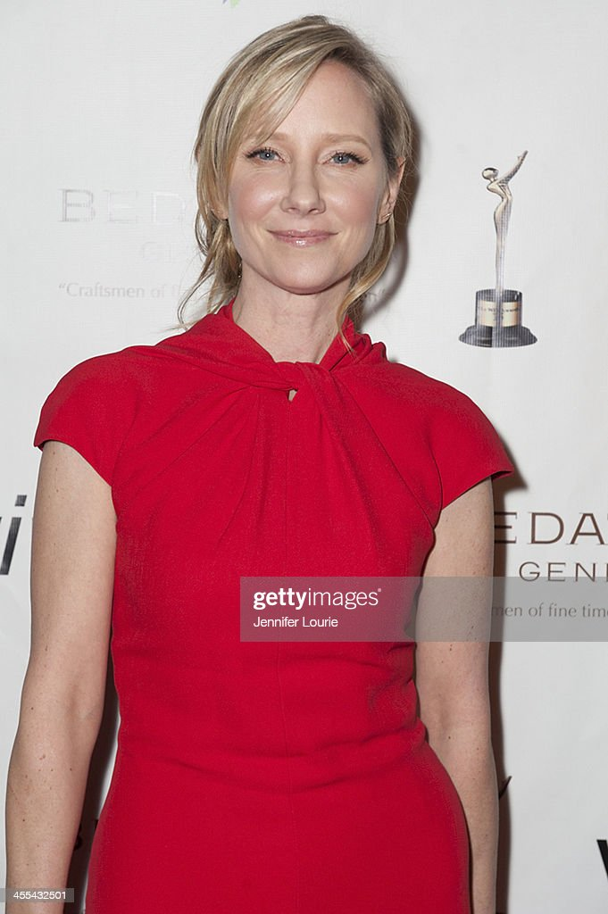 Actress <a gi-track='captionPersonalityLinkClicked' href=/galleries/search?phrase=Anne+Heche&family=editorial&specificpeople=202988 ng-click='$event.stopPropagation()'>Anne Heche</a> arrives at the annual Women's Image Awards at Santa Monica Bay Woman's Club on December 11, 2013 in Santa Monica, California.