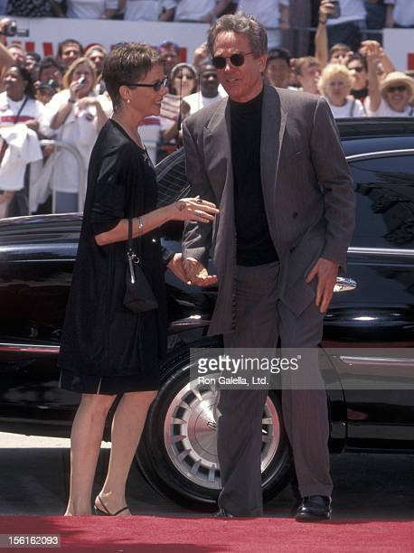 Actress Annette Bening and actor Warren Beatty attend Warren Beatty's hand and footprints in cement on May 21 1998 at Mann's Chinese Theatre in...