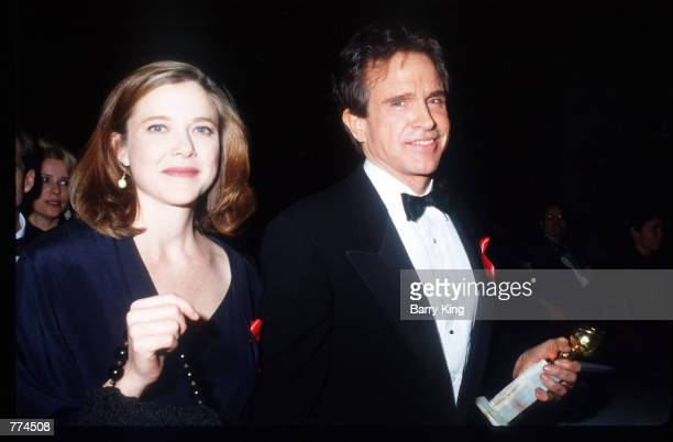 Actress Annette Bening and actor Warren Beatty depart from the Golden Globe Awards January 17 1992 in Los Angeles CA The Golden Globes are presented...
