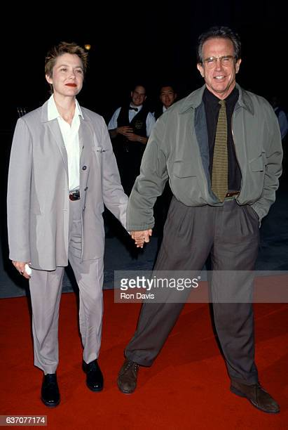 Actress Annette Bening and husband actor Warren Beatty arrive during 'Bridges of Madison County' Los Angeles Premiere on May 30 1995 at the Warner...