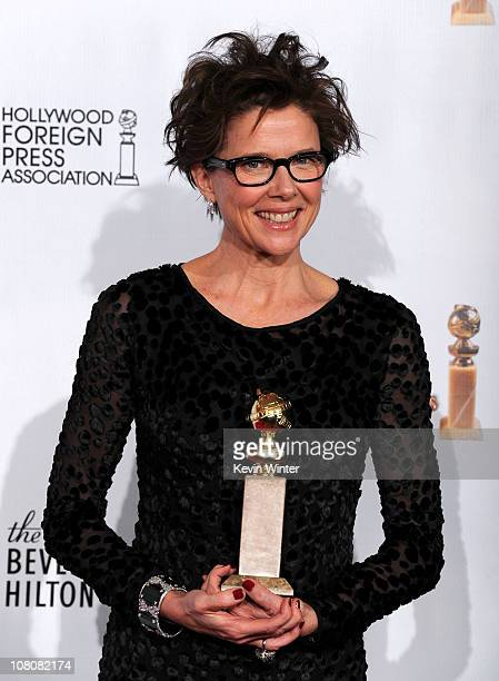 Actress Annette Bening poses with her award for Best Performance by an Actress in a Motion Picture for 'The Kids Are All Right' in the press room at...