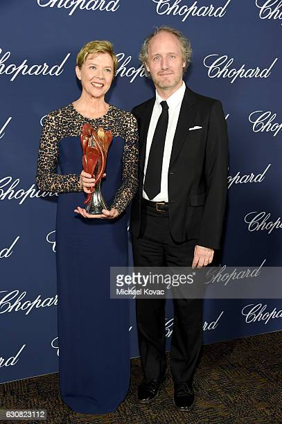 Actress Annette Bening poses with the Career Achievement Award and director Mike Mills during the 28th Annual Palm Springs International Film...