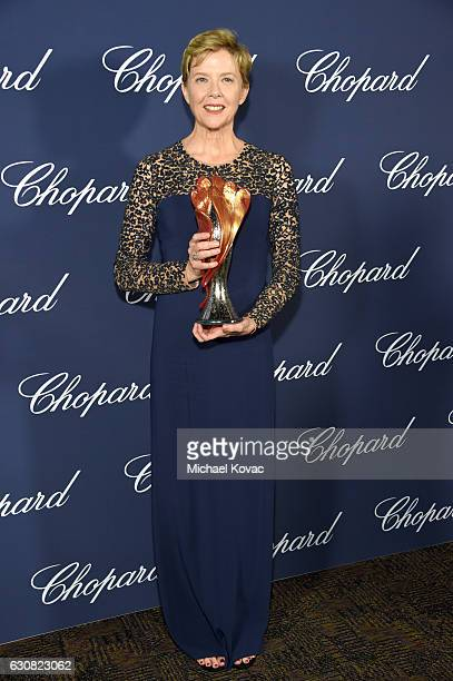 Actress Annette Bening poses with the Career Achievement Award during the 28th Annual Palm Springs International Film Festival Film Awards Gala at...