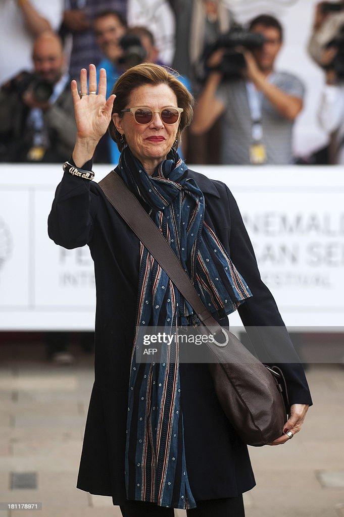 US actress Annette Bening waves as she arrives at the Maria Cristina hotel in San Sebastian on September 19, 2013, during the 61st International Film Festival of San Sebastian.