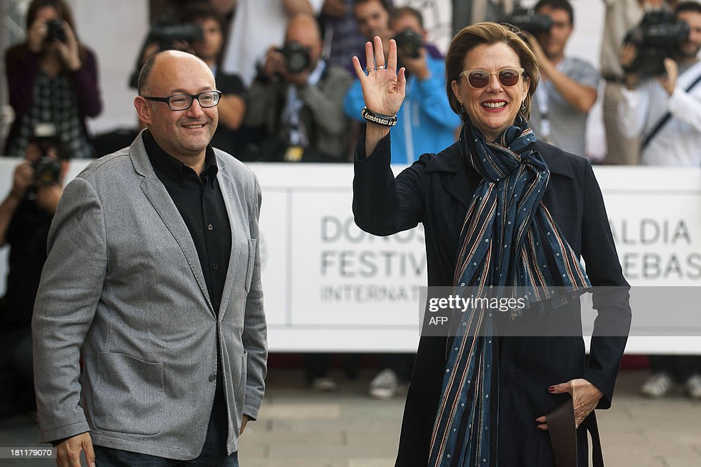 US actress Annette Bening (R) waves next to Jose Luis Rebordinos, director of the San Sebastian International Film Festival, at the Maria Cristina hotel in San Sebastian on September 19, 2013, during the 61st International Film Festival of San Sebastian. AFP PHOTO/ ANDER GILLENEA