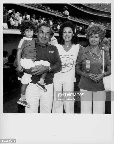 Actress Annette Funicello with her parents Joseph and Virginia and her son at a celebrity baseball game at Dodger Stadium Los Angeles CA August 1978
