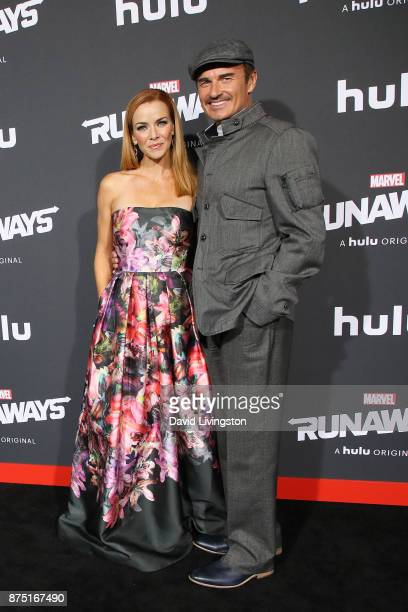 Actress Annie Wersching and actor Julian McMahon arrive at the premiere of Hulu's 'Marvel's Runaways' at the Regency Bruin Theatre on November 16...