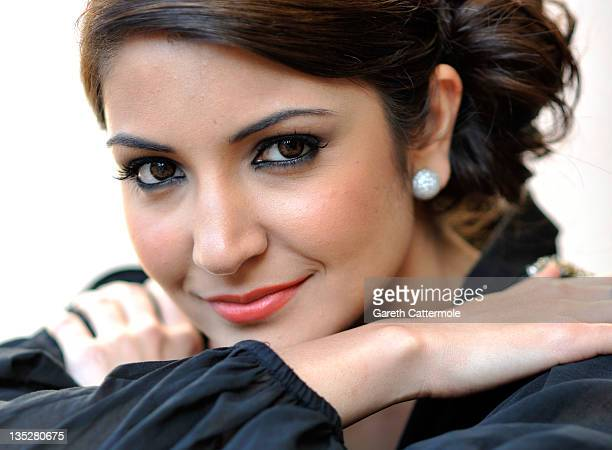 Actress Anushka Sharma poses during a portrait session at the 8th Annual Dubai International Film Festival held at the Madinat Jumeriah Complex on...