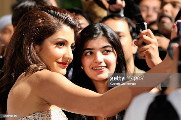 Actress Anushka Sharma poses with fans as she attends the 'Ladies vs Ricky Bahl' premiere during day two of the 8th Annual Dubai International Film...