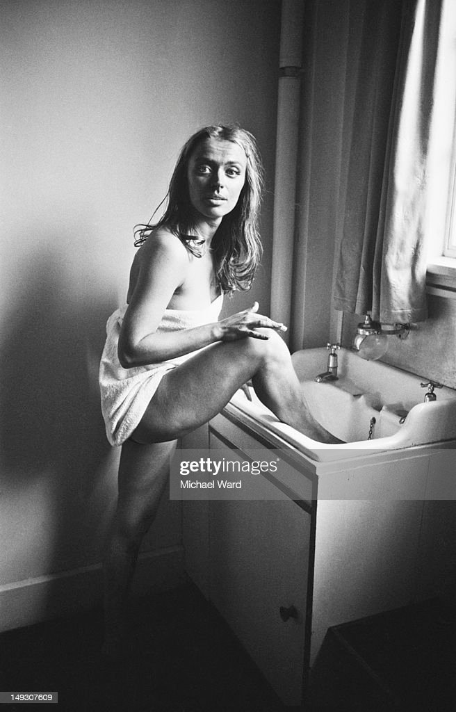 Actress April Olrich washes her feet in a sink inbetween takes of a movie, circa 1960.