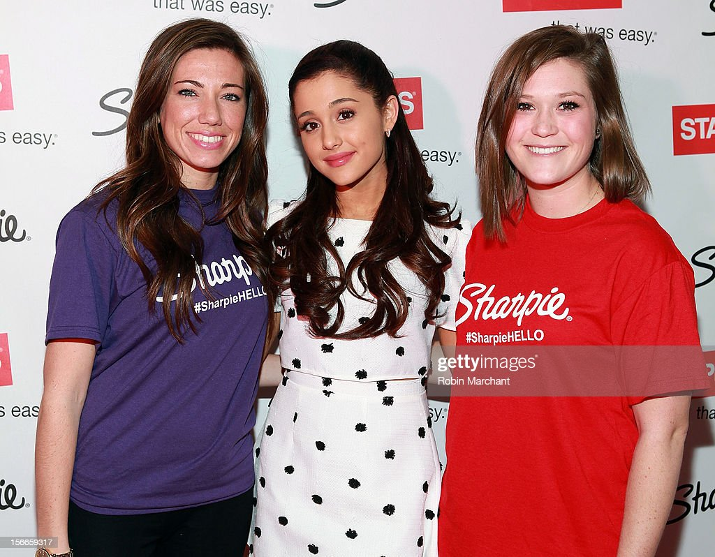 Actress <a gi-track='captionPersonalityLinkClicked' href=/galleries/search?phrase=Ariana+Grande&family=editorial&specificpeople=5586219 ng-click='$event.stopPropagation()'>Ariana Grande</a> (C) Hosts Sharpies One Direction Fan Event at 404 Event Space on November 18, 2012 in New York City.