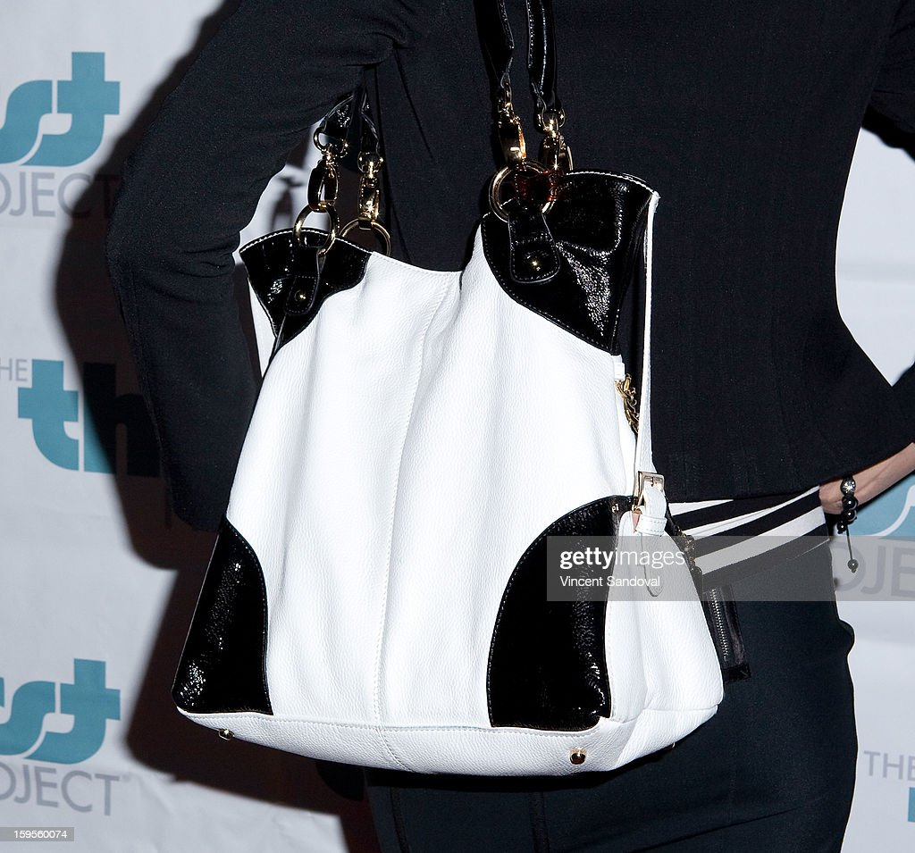 Actress Arianne Zucker (purse detail) attends the Thirst Project charity cocktail party at Lexington Social House on January 15, 2013 in Hollywood, California.