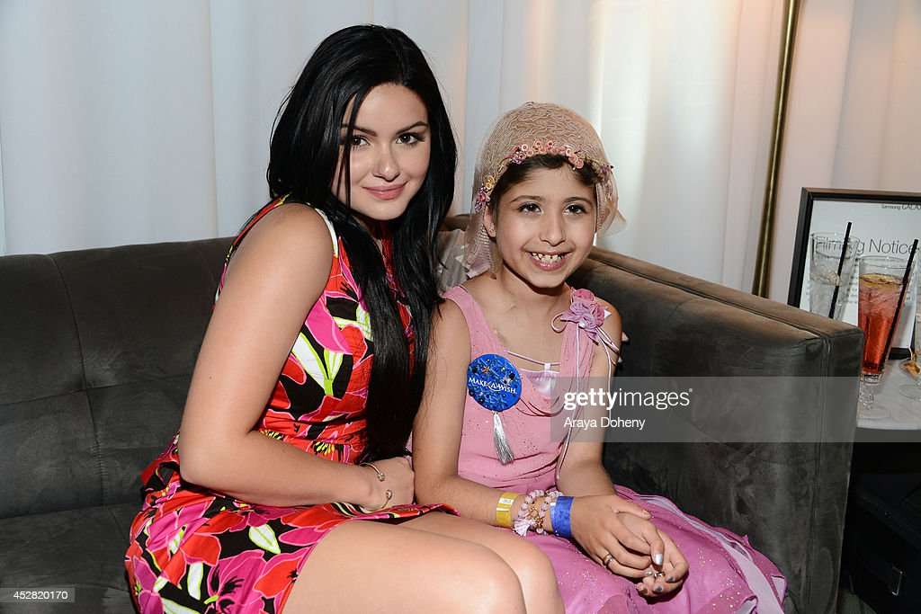 Actress <a gi-track='captionPersonalityLinkClicked' href=/galleries/search?phrase=Ariel+Winter&family=editorial&specificpeople=715954 ng-click='$event.stopPropagation()'>Ariel Winter</a> and Make A Wish recipient Wish Child Grace (R) attend the 2014 Young Hollywood Awards brought to you by Mr. Pink held at The Wiltern on July 27, 2014 in Los Angeles, California.