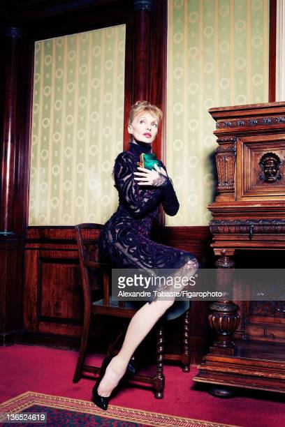 Actress Arielle Dombasle is photographed for Madame Figaro on November 22 2011 in Paris France PUBLISHED IMAGE Figaro ID 102448002 Dress by Emilio...
