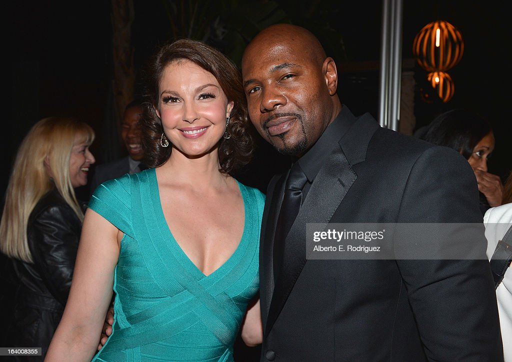 Actress Ashely Judd and director Antoine Fuqua attend the after party for the premiere of FilmDistrict's 'Olympus Has Fallen' at Lure on March 18, 2013 in Hollywood, California.