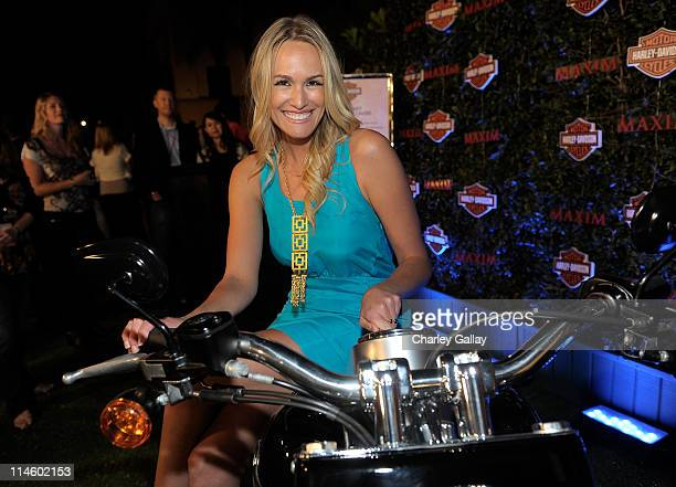 Actress Ashlan Gorse turns the key on a HarleyDavidson to raise money for Harley's Heroes at the 2010 Maxim Hot 100 Party held at Paramount Studios...