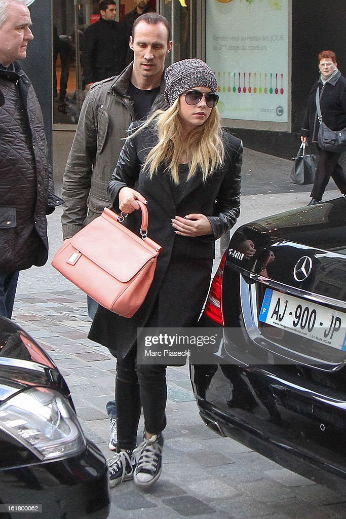Actress Ashley Benson arrives at the 'Printemps' department store on February 16, 2013 in Paris, France.