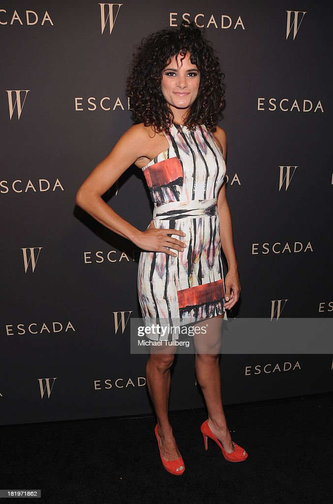 Actress Ashley Dyke attends the 'Celebrate Cool Earth' benefit for the Cool Earth Foundation at Escada Boutique on September 26, 2013 in Beverly Hills, California.