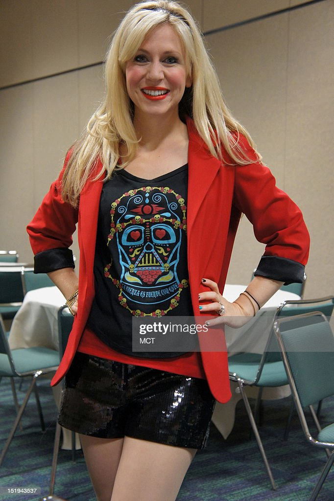 Actress Ashley Eckstein models her 'Day of the Dead' Darth Vader tee shirt from her business Her Universe at Celebration VI, the mega Star Wars convention in Orlando, Florida, August 24, 2012.