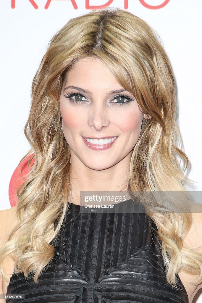 Actress Ashley Greene poses in the iHeartRadio music festival photo room on September 20, 2013 in Las Vegas, Nevada.