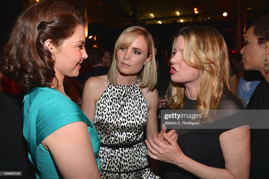 Actress Ashley Judd, actress Radha Mitchell and executive producer Heidi Jo Markel attend the after party for the premiere of FilmDistrict's 'Olympus Has Fallen' at Lure on March 18, 2013 in Hollywood, California.