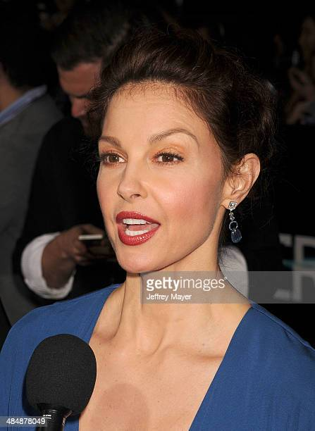 Actress Ashley Judd arrives at the Los Angeles premiere of 'Divergent' at Regency Bruin Theatre on March 18 2014 in Los Angeles California