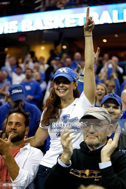 Actress Ashley Judd celebrates after the Kentucky Wildcats defeated the Notre Dame Fighting Irish during the Midwest Regional Final of the 2015 NCAA...
