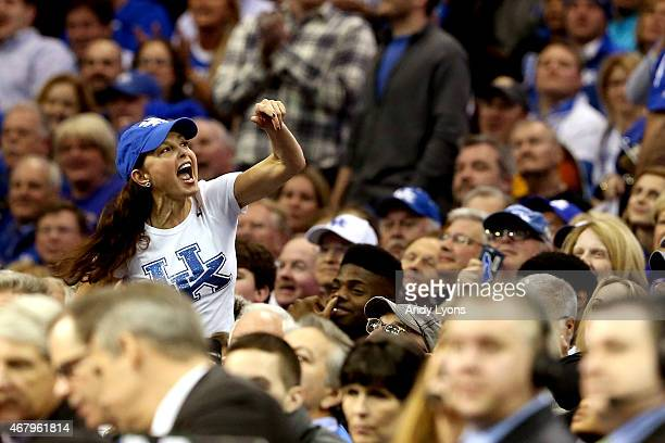 Actress Ashley Judd cheers in the crowd during the game between the Kentucky Wildcats and the Notre Dame Fighting Irish during the Midwest Regional...