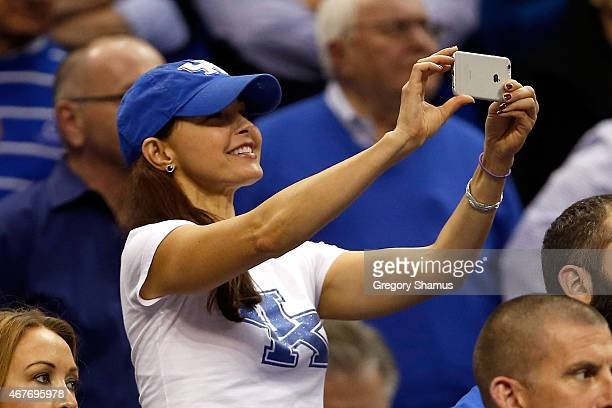 Actress Ashley Judd looks on in the second half of the game between the Kentucky Wildcats and the West Virginia Mountaineers during the Midwest...