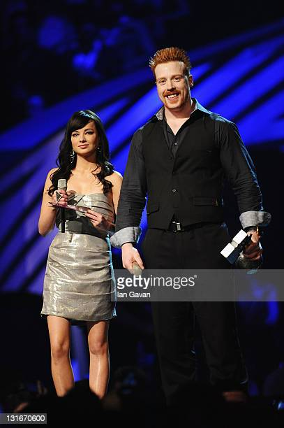 Actress Ashley Rickards and wrestler Sheamus speak onstage during the MTV Europe Music Awards 2011 live show at at the Odyssey Arena on November 6...