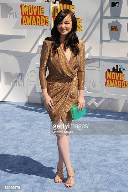 Actress Ashley Rickards arrives at the 2015 MTV Movie Awards at Nokia Theatre LA Live on April 12 2015 in Los Angeles California