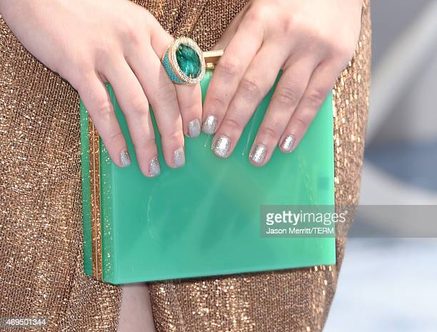 Actress Ashley Rickards fashion detail attends The 2015 MTV Movie Awards at Nokia Theatre LA Live on April 12 2015 in Los Angeles California