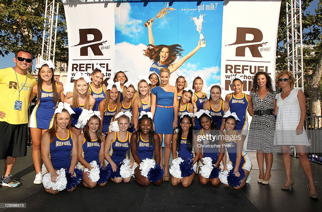 Actress <a gi-track='captionPersonalityLinkClicked' href=/galleries/search?phrase=Ashley+Tisdale&family=editorial&specificpeople=213972 ng-click='$event.stopPropagation()'>Ashley Tisdale</a> (3rd to R), American Cheerleader Magazine Editor-in-chief Marisa Walker (2nd to R), and Miranda Abney of MilkPEP (R), pose onstage with the Refuel cheerleaders during the 'Be Strong' Challenge with <a gi-track='captionPersonalityLinkClicked' href=/galleries/search?phrase=Ashley+Tisdale&family=editorial&specificpeople=213972 ng-click='$event.stopPropagation()'>Ashley Tisdale</a> held at The Grove on August 30, 2011 in Los Angeles, California.