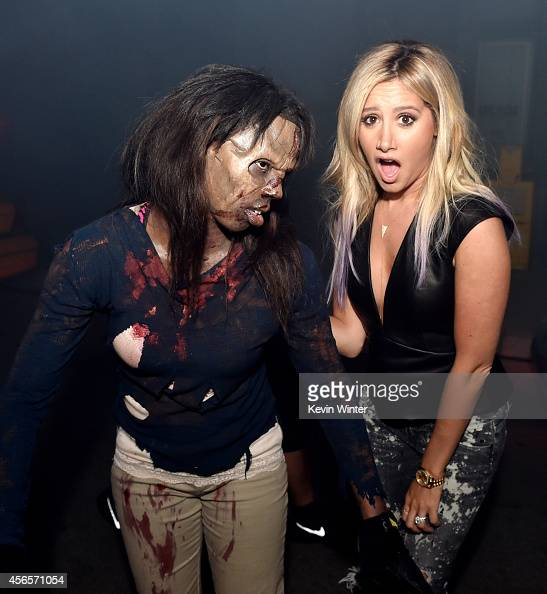 Actress Ashley Tisdale poses at the after party for the premiere screening of AMC Networks' 'The Walking Dead' Season 5 at the Universal Studios...