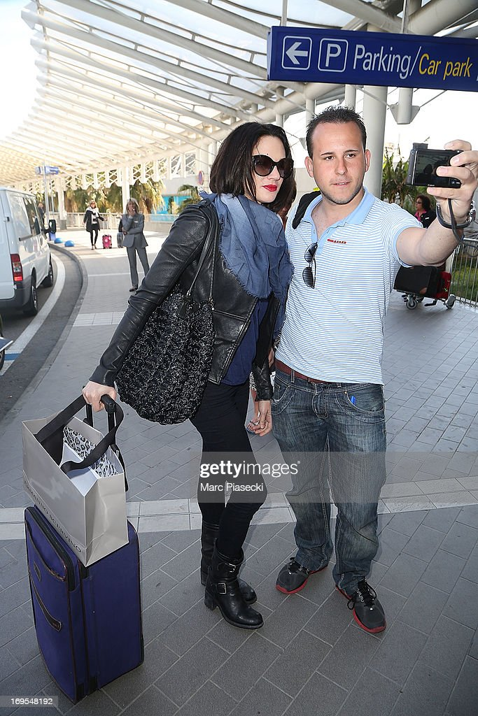 Actress Asia Argento poses with fan as she is sighted at Nice airport after the 66th Annual Cannes Film Festival on May 27, 2013 in Nice, France.
