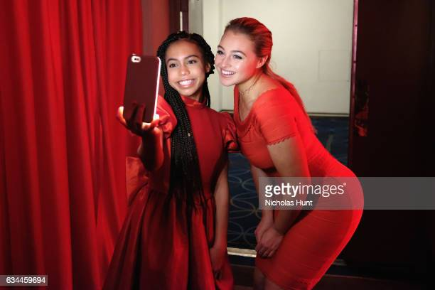 Actress Asia Monet Ray and model Iskra Lawrence attend the American Heart Association's Go Red For Women Red Dress Collection 2017 presented by...