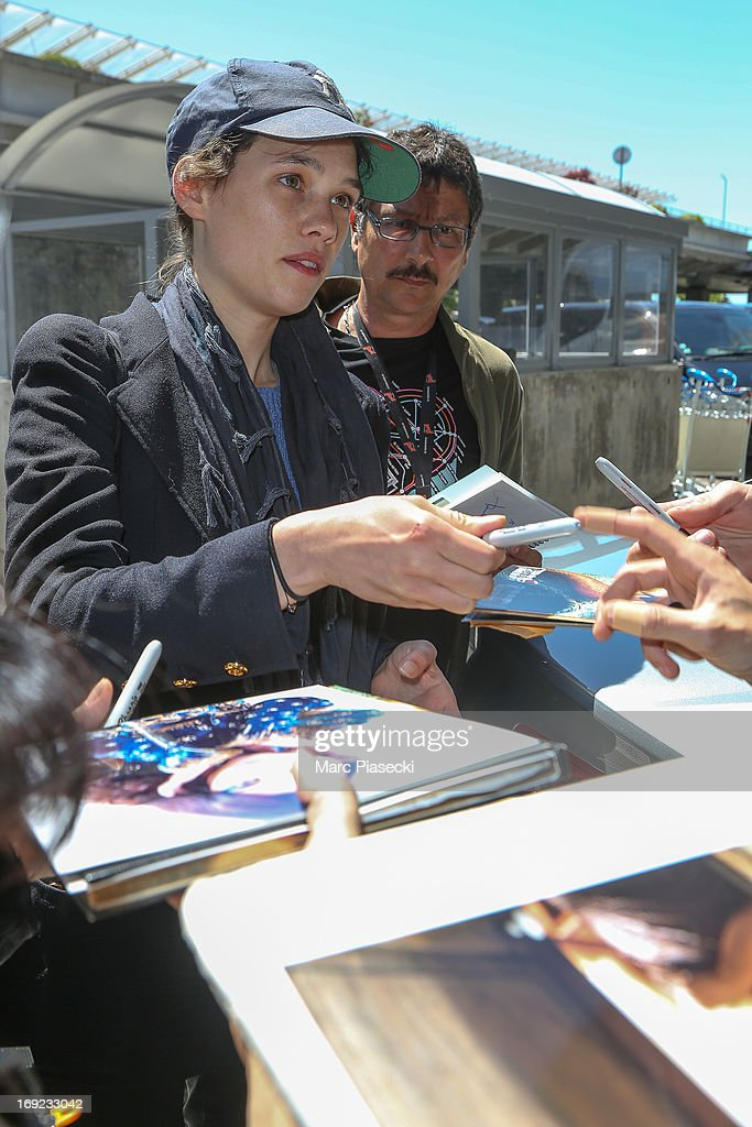 Actress Astrid Berges-Frisbey signs autographs as she is seen at Nice airport during the 66th Annual Cannes Film Festival on May 22, 2013 in Nice, France.