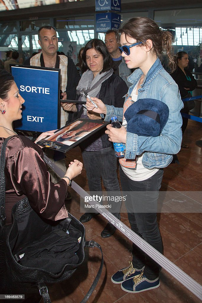 Actress Astrid Berges-Frisbey signs autographs as she is sighted at Nice airport during the 66th Annual Cannes Film Festival on May 25, 2013 in Nice, France.